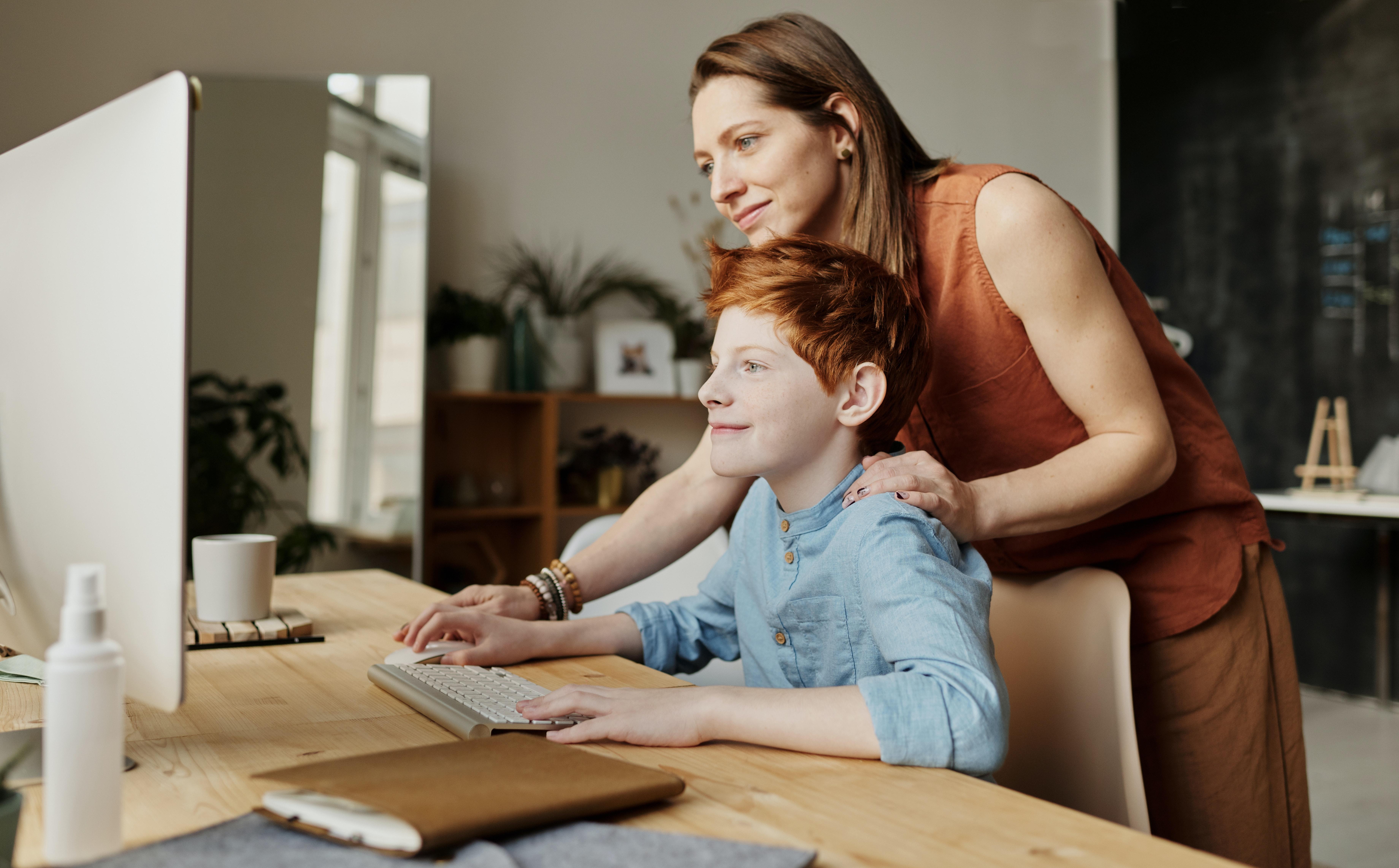 Woman Teaching Son